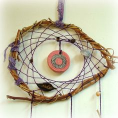 Mandala dream catcher - natural baby mobile weaved in purple with black pod and dried pomegranate. $33.00, via Etsy.
