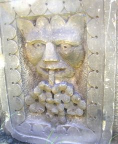 Green Man carving (thought by some to be medieval, but probably Victorian) in Dundee Cemetery, Scotland (photo John W. Schulze)
