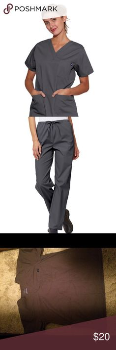 👩⚕️Grey Scrub set 👩⚕️ Grey scrub set. The price of scrubs now a days is outrageous! Your spending over 60 dollars for a set. I love this set, but my company went color coded on me 😞 They are flexible and comfortable for the busy workday Tafford Other