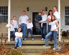 large extended family picture taken on the front porch simple and