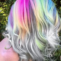 There were so many shots of this look on @sandi_rose tag-teamed at ISSE by @caitlintyczka and I... that I'll prolly never be sick of looking at it. Just reminds me of a rainbow peeking through the clouds on a stormy day ⛅️🌈 @brazilianbondbuilder @kenraprofessional #rainbowhair #rainbowroots #silverhair #greyhair #colorfulhair #hairstyle #haircolor #hair