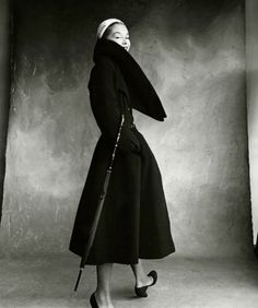 Lisa Fonssagrives-Penn wearing coat with large collar by Dior, holding umbrella © Condé Nast Vogue, 1950 as seen on Vogue Tumbler