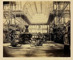 This photograph of 1854 shows the interior of the Crystal Palace in south London. The Crystal Palace housed the Great Exhibition of the Works of Industry of All Nations in Exhibition Building, Exhibition Space, Crystal Palace, Hyde Park, The Woman In White, Palace Interior, Palace London, Glass Structure, London History