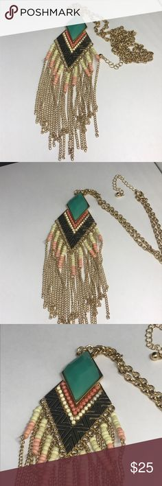 """Tribal gold peach turquoise statement necklace Long tribal style necklace. Gold tone, with cream, black, peach and turquoise. Size shown in pic in my hand for reference. Pendant piece 5"""" long. Jewelry Necklaces"""
