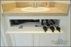 Take back thatdead cabinet space by turning the front piece into a tilt-out storage spot. This DIYer keeps her hot tools (and their unruly cords) orderly, thanks to this hack. See more at Remodelaholic »