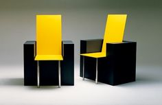 Yellow chair on black chair