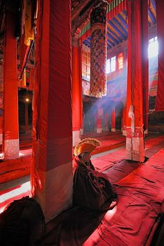 A monk in a Buddhist Temple in Lhasa, Tibet ©Jim Richardson All rights reserved. You can see more of my work at: www.jimrichardsonphotography.com Follow me on Instagram: @Jim Richardson. Flickr.com Photoshare. JC's Photostream
