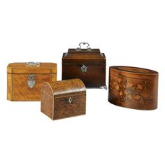 A George III mahogany tea caddy circa 1760 with a silver swan-neck handle and…