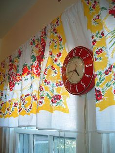 So bright and cheerful!  Love the vintage clock and the tablecloth curtains are adorable!