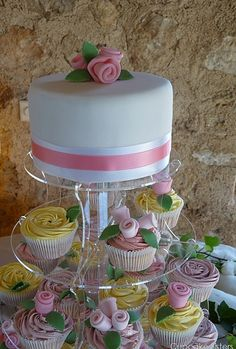 Google Image Result for http://www.thecupcakeblog.com/wp-content/uploads/2010/06/Ribbon-Rose-Wedding-Cupcake-Tower.png