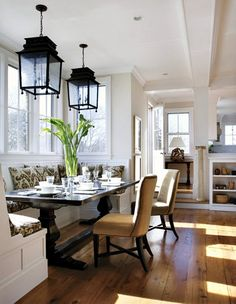 Banquette seating make effective use of a small space for family breakfasts.