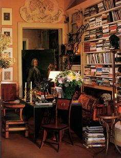 "Jacques Grange's Paris apartment."" [V]iew of the library that leads through from the living room to the dining room. The portrait is century, the drawing over the door is by Bérard, the bronzes are from the and the chair in the foreground. Home Libraries, Interior Decorating, Interior Design, Decorating Ideas, Paris Apartments, Reading Room, Book Nooks, Decoration, Interior And Exterior"