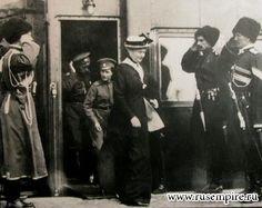 Empress Alexandra, Tsarevich Alexei, Tsar Nicholas II exiting a train.