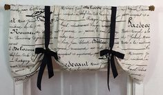 The ever popular French script fabric is made into a tie up valance with grosgrain ribbon. Printed on a natural duck , the black script also features