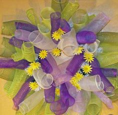 Another curly wreath with flowers made from four different colors of deco mesh.
