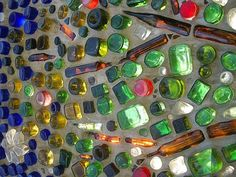 22 Glass Recycling Ideas to Reuse and Recycle Empty Bottles bottle wall Wine Bottle Wall, Bottle House, Bottle Garden, Bottle Art, Bottle Crafts, Recycled Glass Bottles, Empty Bottles, Bottles And Jars, Bottle Candles
