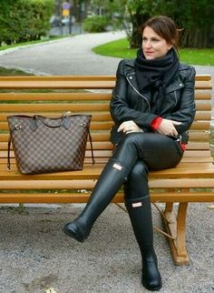 Black leather jacket and leggings with rubber boots