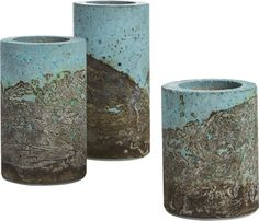 concrete landscape.  Three concrete pillars cement the creative vision of industrial designer Nick Wrona.  Handcrafted in his Indiana studio Urban Concrete, the planters were first created as a Mother's Day gift.  Abstracting the look of a natural landscape on an industrial material, the concrete forms are stained sky blue, then wrapped by hand in acid-soaked shop towels to create textural forms that make each unique.