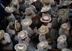 Churchgoers, French Polynesia Women wear white dresses and hats during a Sunday sermon in Papeete, Tahiti, French Polynesia's steamy capital.