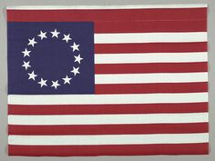This commemorative textile was printed for the US Bicentennial in 1976. Manufactured by Hancock Fabrics, it is a reproduction of an early US flag with thirteen alternating red and white stripes and thirteen white stars. Cooper Hewitt acquired it in 1977. #flagday