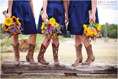 seriously love me some rustic weddings! cowboy boots and sunflowers?! so fun!