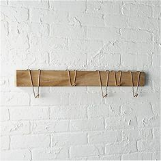 Shop dip coat rack.   Saal wood reclaimed from old Indian railroad ties gets upcycled into an elegant, everyday storage solution.  Minimalist plank supports 5 copper hooks that slide back and forth to accommodate coats, bags and the rest.