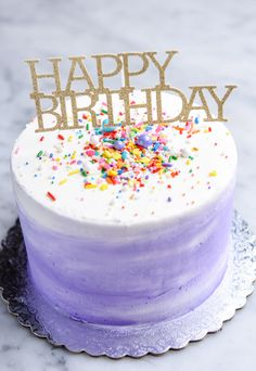 """Classic vanilla birthday cake with your choice of watercolor buttercream & sprinkles or all-over white rose Dietary Modifications: * Can be made Egg Free * Can be made Gluten Free (contains eggs) * Can be made Vegan (select for dairy free) 6"""" aprox 10-18 servings"""