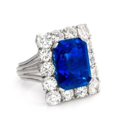 An Important Platinum, Burmese Sapphire and Diamond Ring, containing one octagonal step cut weighing approximately carats with 14 round transitional brilliant cut diamonds weigihng approximatel. Fine Jewelry, Jewellery, Platinum Ring, Burmese, Cocktail Rings, Minerals, Heart Ring, Sapphire, Diamonds