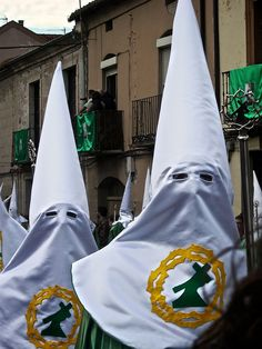 ZAMORA Semana Santa - NOT American KKK - but this is where the KKK got the inspiration for their costumes. This is a Catholic Procession in Spain held during Holy Week. Members of Lay Brotherhoods wear the conical cap and face covering (in different colors for each Order) as a sign of penitence. Peaked caps like this were also placed on the guilty during the Inquisition. It is where the dunce caps in school days of old came from! (How fitting that the KKK chose a symbol of shame!)