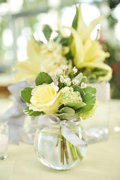Yellow and green wedding centerpieces...throw some long pretty brown twigs in there and you've got my cup of tea!