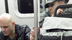 Powerful photo captures woman's touching gesture to aggressive man on train >>> When others shied away from - or taunted - the erratic man, this 70-yr old woman reached out and calmed him with a clasp of her hand.  The world needs more people like this woman.