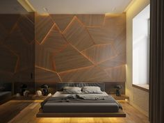 This bedroom takes texture to the next level using molded wall panels combined with creative dynamic lighting .