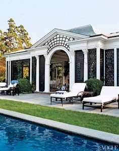 Love the minimal cement and the grass around the edge of pool.