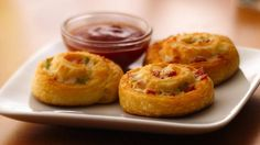 Serve pizza toppings swirled in a tender crescent pastry with a dipping sauce at your next get-together.