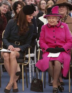 Watching a fashion show ... the Queen Elizabeth and Catherine, Duchess of Cambridge.