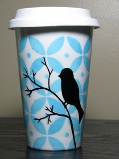 Painted Travel Mug- Pop Of Color, Sky Blue with Bird Silhouette. $35.00, via Etsy.