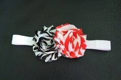 "Baby girl red and black flower with white elastic headband. Flowers measure 3.5"" across. UGA game day headband. on Etsy, $7.00"