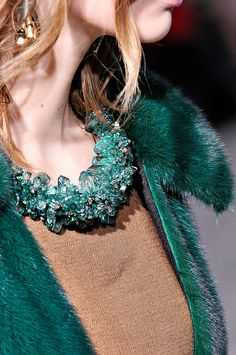Teal stones and fur coat with auburn top and hair. Subtle matching, great outcome! Jewel colours