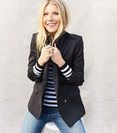 Gwyneth Paltrow wearing #goopLabel black blazer, striped tee, and jeans