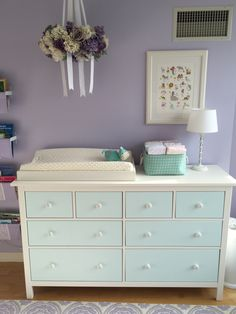 Ikea Hemnes dresser (painted of course) and hand-painted flowers on unfinished wooden knobs.