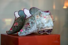 Foot-binding Chinese Slippers. China, end of the 19th century - early 20th century. Only 11cm long. Materials: satin, silk, cotton, commercial ribbon. Photo: Kathryn Yuen