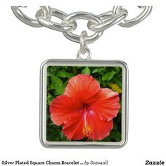 Sterling Silver Plated Charm Bracelet with Red Hibiscus Square Charm.  Put a piece of paradise on someone's wrist today!