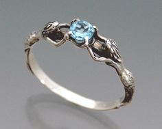 Two Mermaids Ring with Blue Topaz
