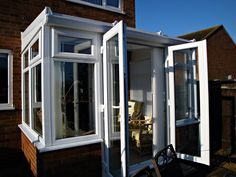 White PVCu Self-Build Lean-to Conservatory, Dwarf-Wall Model. Sunlounge DIY Conservatories Manufactured and supplied by ConservatoryLand DIY Conservatories UK. Conservatory pictures kindly supplied by our customers.
