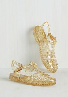 Saved by the Jelly Sandal in Gold Glitter. When your day needs a dose of playful sparkle, you step right into these quirky jelly sandals. #gold #modcloth