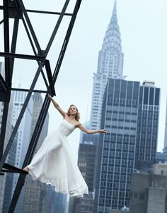 Kate Winslet hangs from a New York skyscraper, her Ralph Lauren dress fluttering in the breeze. 'Kate is only a short way off the ground, but it looks as if she is risking life and limb.' Shot by Peter Lindbergh for August 2009.