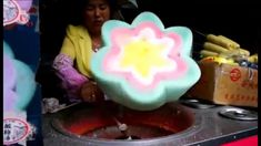 A market trader in China showed great skill sculpting an intricate flower out of candy floss. The video is filmed by a tourist in Ciqikou and it shows the se...