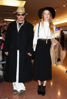 Dressing together: Johnny Depp and Amber Heard co-ordinate their style with camel, black and white ensembles as they arrive in Tokyo at the Haneda Airport