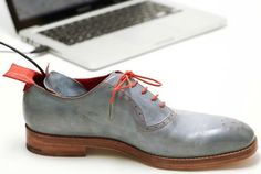 gps-shoes-One of the shoes has a GPS chip embedded within the sole and an antenna in a red ankle tag. You just plug a USB cable into the sole before you leave, plotting the location of your destination on a map using custom software