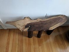 Unique handcrafted Black Walnut occasional table, freeform shaped like the head of an alligator, legs made from Dogwood trunk, resembling the textured armor of the alligators skin. This sturdy occasional table has copper inlay for the eye and part of the mischievous gator grin, the teeth